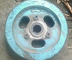 cara+melepas+roda+gila+mesin+diesel